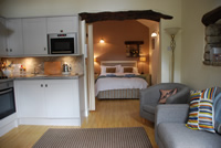 Image: Swallow Barn 4 star self catering cottage lounge.